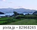 舞鶴湾の舞鶴クレインブリッジと里山の風景 82968265
