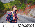 Travel man with backpack hiking in the mountains 82986504
