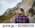 Travel man with backpack hiking in the mountains 82986506