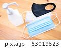 テーブルの上のアルコールと色々なマスク 新型コロナウイルス感染防止対策 消毒除菌 予防 83019523