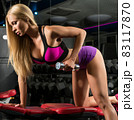 Gorgeous blonde training with dumbels in a gym 83117870