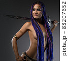 Sexy confident woman with sword in studio 83207652