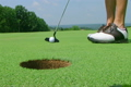 Golfer Sinks Putt 02 2613826