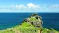 南国の奇岩とヨット 6946432