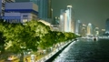 People walk by quay with traffic near Pearl river and cityscape 7889008
