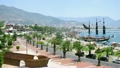 Big model of wooden boat stands near port of Alania, time lapse 7889010