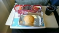 Tray of food: salad, fruit, bread, drink on the plane. 7889079