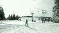 Amazing view at ski slope full of skiers 8999242
