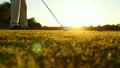 Slow Motion Golf Tee Shot At Sunset  10175928