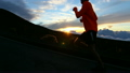 Slow Motion - Silhouette Man Running At Sunset Outside 10349630