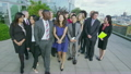 Portrait of attractive diverse business team outside city office building 11410291