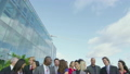 Portrait of cheerful diverse business team with blue sky and white clouds 11410920