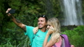 Young Happy Couple Taking Selfie Photo Outside By Waterfall  11573913