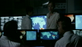 Security personnel working in system control room. 11574299