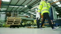 Time lapse of busy warehouse workers lifting and moving goods and materials 11588563