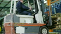 Time lapse of busy warehouse workers lifting and moving goods and materials 11588569