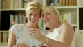 Family happiness and memories, happy mother and daughter looking at pictures in photo album at home 12860222