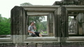 caucasian tourist talking with mobile phone in angkor  13262277