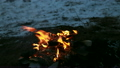 Burning wood, outdoor winter campfire macro video   14006768