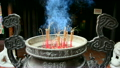 Incense Sticks Burning in Giant Pot in Front of Buddhist Temple  14070129