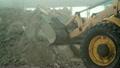 Bulldozer in warehouse 14644576