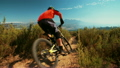 High angle view of mountain biker riding a dirt path downhill 14948116