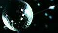 Disco mirrorball spinning and reflecting light 15234400