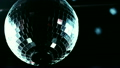 Disco mirrorball spinning and reflecting light 15234401