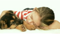 beautiful girl sleeps embracing Shepherd puppy 15695954