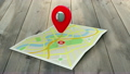 Red marker pointing at a map of a town 16479937