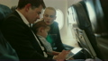 Family of three in plane with smartphone and tablet PC 16580839