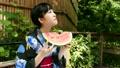 若い女性 浴衣 和服 黒髪  すいかを食べる FIX 16874959