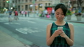 Young Asian woman texting cell phone 17682578