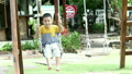 Asian baby boy playing on a swing and having fun 18718251