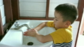 Little boy washing hand in seven step with smiling 18718473