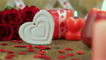 Red roses and heart shape on wooden background 19974561