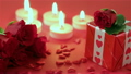 Red roses and gift box on red background 19974564