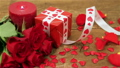 Red roses and gift box on wooden background 19974587