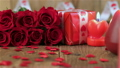 Red roses and gift box on wooden background 19974588