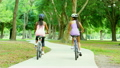 Young happy multi ethnic American women cycling to keep healthy 20374880