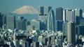 東京タイムラプス 絶景 富士山と新宿高層ビル街 快晴 山頂に吹き上げる雲 ティルトアップ 20589725