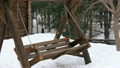 wooden swing in the forest winter 21225703