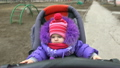 Adorable, Attractive Little Baby Girl in  Baby Car 21726028