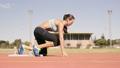Athlete woman starting running  21852482