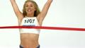 Woman crossing finish line 21852494