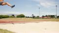 Sportswoman doing long jump 21852534