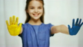smiling girl showing painted hands 22763992