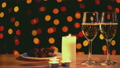 Cinemagraph of glowing candles and wine glasses  22808434