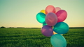 Little girl child kid with balloons outdoors on 23435403