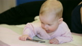 Baby with cell phone 23558075